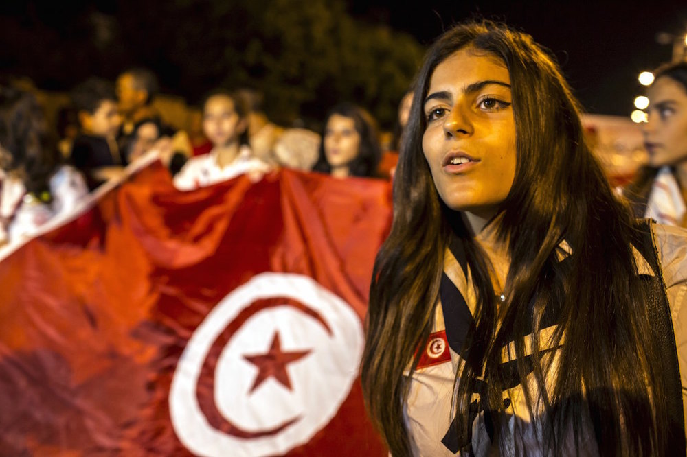 A woman attends a protest to condemn an attack by a gunman at the beach of the Imperial Marhabada  hotel in Sousse