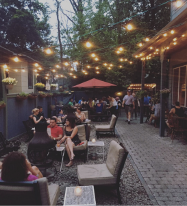 The terrace of the Huckleberry Bar on a summer night via @sillybimkiss on Instagram.